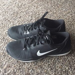 Black and white nike shoes. Size 8